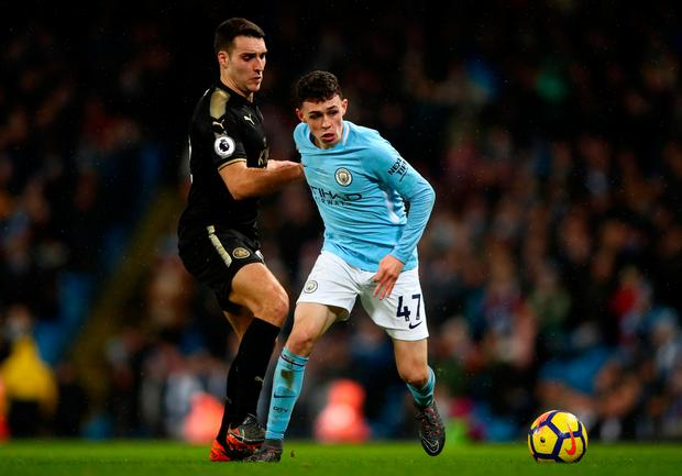 Matty James of Leicester City and Phil Foden of Manchester City battle for the ball. Photo: Getty Images