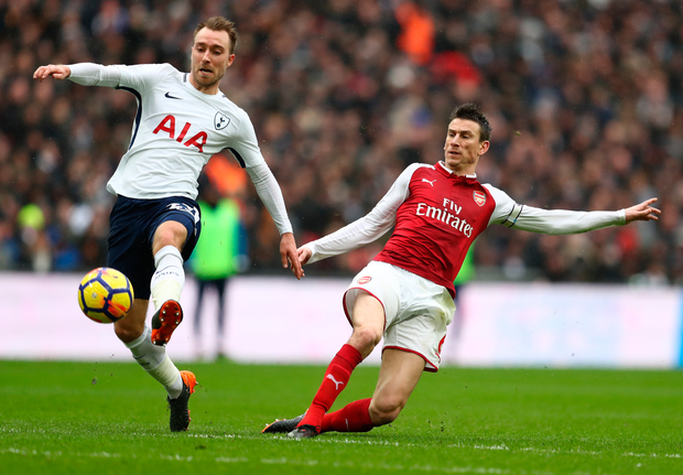 Christian Eriksen of Tottenham Hotspur and Laurent Koscielny of Arsenal. Photo: Getty Images