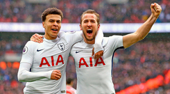 Harry Kane celebrates with Dele Alli after scoring the goal which won yesterday's North London derby. Photo: PA Wire