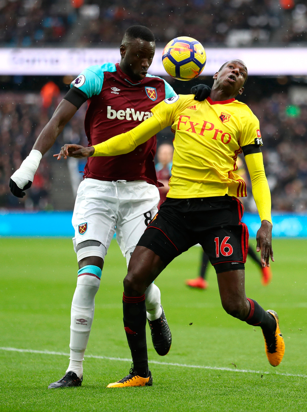 Abdoulaye Doucoure of Watford is challenged by Cheikhou Kouyate of West Ham United. Photo: Getty Images