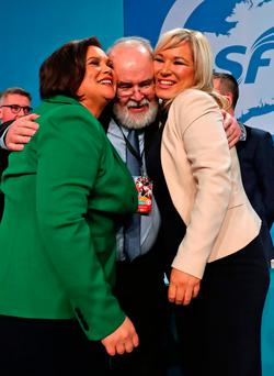 Sinn Fein's newly elected president Mary Lou McDonald (left) and vice president Michelle O'Neill are hugged by Francie Molloy MP at the party's special conference at the RDS. Photo: PA Wire