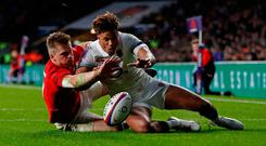 England's Anthony Watson in action with Wales' Gareth Anscombe before a try is disallowed for Wales