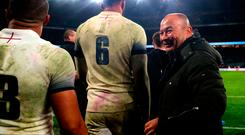 England coach Eddie Jones congratulates his players after the final whistle