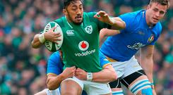 Ireland's centre Bundee Aki is tackled during the Six Nations international rugby union match between Ireland and Italy at the Aviva Stadium