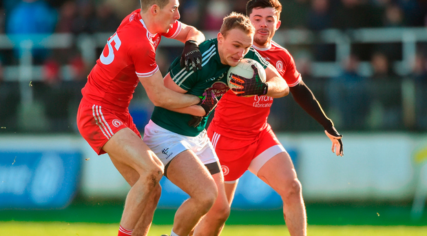 Tommy Moolick of Kildare in action against Padraig McNulty, left, and Ciarán McLaughlin of Tyrone