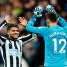 Soccer Football - Premier League - Newcastle United vs Manchester United - St James' Park, Newcastle, Britain - February 11, 2018 Newcastle United's DeAndre Yedlin celebrates with Martin Dubravka at the end of the match Action Images via Reuters/Carl Recine