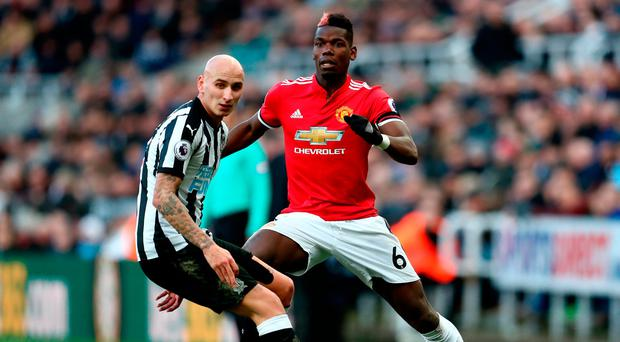 NEWCASTLE UPON TYNE, ENGLAND - FEBRUARY 11: Paul Pogba of Manchester United is challenged by Jonjo Shelvey of Newcastle United during the Premier League match between Newcastle United and Manchester United at St. James Park on February 11, 2018 in Newcastle upon Tyne, England. (Photo by Catherine Ivill/Getty Images)
