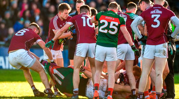 Aidan O'Shea of Mayo is removed from an altercation by Paul Conroy of Galway