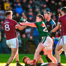Cillian O'Connor of Mayo clashes with Paul Conroy of Galway