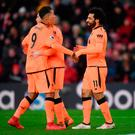 Mohamed Salah of Liverpool celebrates after scoring his sides second goal with Roberto Firmino of Liverpool and Andy Robertson