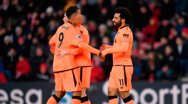 SOUTHAMPTON ENGLAND- FEBRUARY 11 Mohamed Salah of Liverpool celebrates after scoring his sides second goal with Roberto Firmino of Liverpool and Andy Robertson of Liverpool during the Premier League match between Southampton and Liverpool at St Mary's
