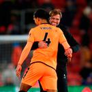 SOUTHAMPTON, ENGLAND - FEBRUARY 11: Jurgen Klopp, Manager of Liverpool and Virgil van Dijk of Liverpool celebrate victory together after the Premier League match between Southampton and Liverpool at St Mary's Stadium on February 11, 2018 in Southampton, England. (Photo by Julian Finney/Getty Images)