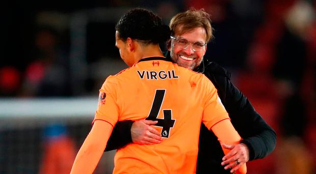 SOUTHAMPTON ENGLAND- FEBRUARY 11 Jurgen Klopp Manager of Liverpool and Virgil van Dijk of Liverpool celebrate victory together after the Premier League match between Southampton and Liverpool at St Mary's Stadium