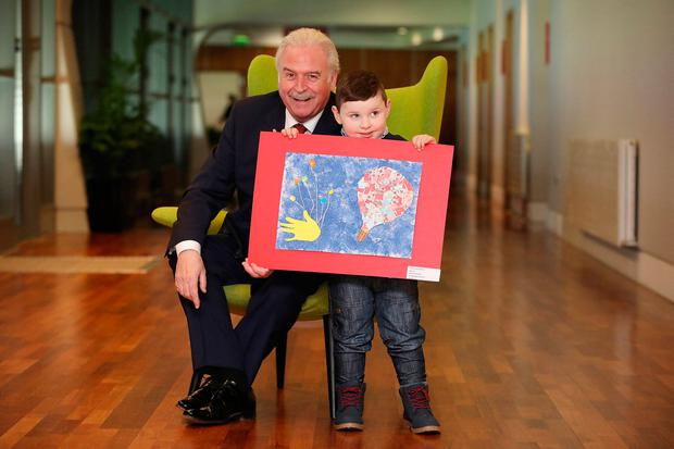 Nathan Richardson winner in the 7 Years and under category from Nenagh Co.Tipperary with MC Marty Whelan at the National Prize-Giving Ceremony for the Credit Union All Ireland Art Competition at Croke Park. Photo: Julian Behal