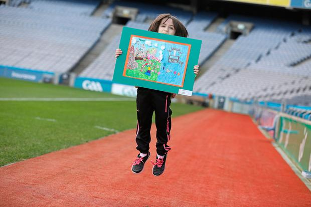 Mary Ann McMackin from Omagh, Co.Tyrone, winner in the 8-10 category jumps for joy. Photo: Julian Behal
