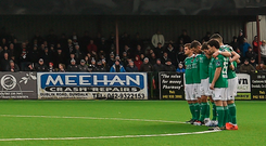 Players from Dundalk and Cork observe a minute's silence before their President's Cup match at Oriel Park. Photo: Sportsfile