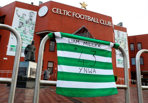 Celtic pay tribute to their former player at Celtic Park where the flags few at half mast. Photo: PA