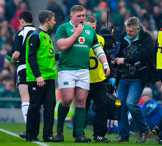 Tadhg Furlong is helped from the field by Ireland medics.Photo: Sportsfile