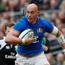 Sergio Parisse gets away from Joey Carbery in what proved to be a 96th defeat in an Italian shirt. Photo: Reuters