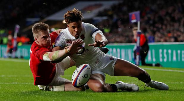 England's Anthony Watson and Gareth Anscombe of Wales battle to ground the ball first in an incident which Wales claim should have been awarded as a try. Photo: Reuters