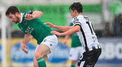 Cork City's Gearóid Morrissey takes extra care in the snowy conditions as he gathers possession under pressure from Dundalk's Jamie McGrath during the President's Cup match at Oriel Park. Photo: Sportsfile
