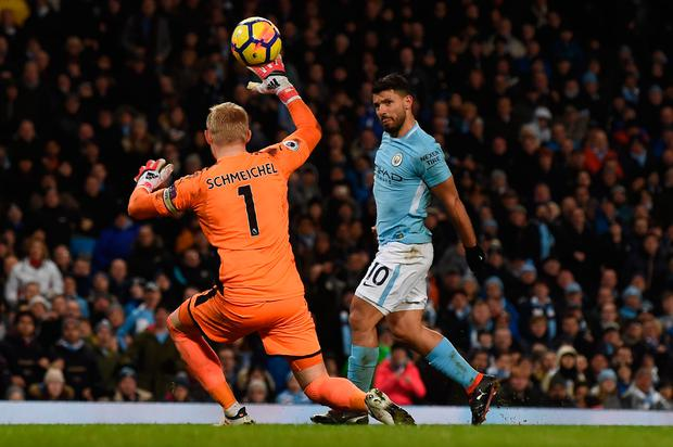 Sergio Aguero chips the ball over Kasper Schmeichel to score Manchester City's fourth goal at the Edihad Stadium. Photo: Getty Images