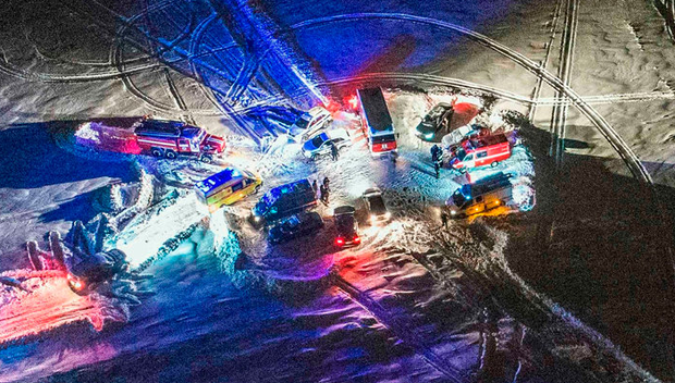An ariel view in the Ramensky district on the outskirts of Moscow shows Russian emergency vehicles arriving near to the site of the airplane crash. Photo: Dmitry Serebryakovdmitry/Getty