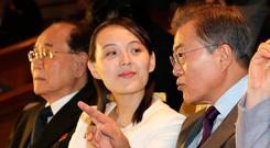 South Korean President Moon Jae-in talks with Kim Yo Jong, the sister of North Korea's leader Kim Jong Un, while watching North Korea's Samjiyon Orchestra's performance in Seoul. Photo: REUTERS