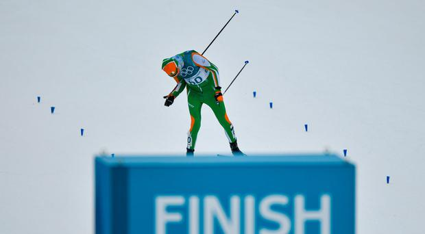Norway's Krueger wins gold in skiathlon after early crash