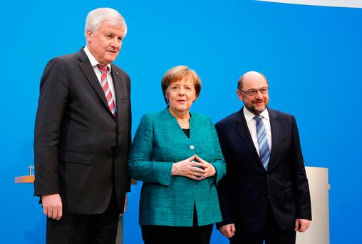 Merkel defends painful coalition concessions, denies authority waning
