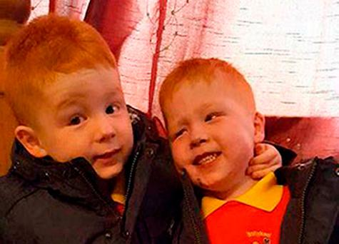 Kayden Fleck (right) with his twin brother Jayden (left) Credit: PSNI/PA Wire