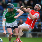 Cuala's Con O'Callaghan is knocked to the ground by the challenge of Michael Conneely of Liam Mellows during Saturday's AIB All-Ireland Club SHC semi-final at Semple Stadium. Photo: Matt Browne/Sportsfile