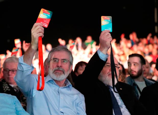 Gerry Adams votes for Michelle O'Neill to become the Sinn Féin vice president at the party's special conference. Photo: PA