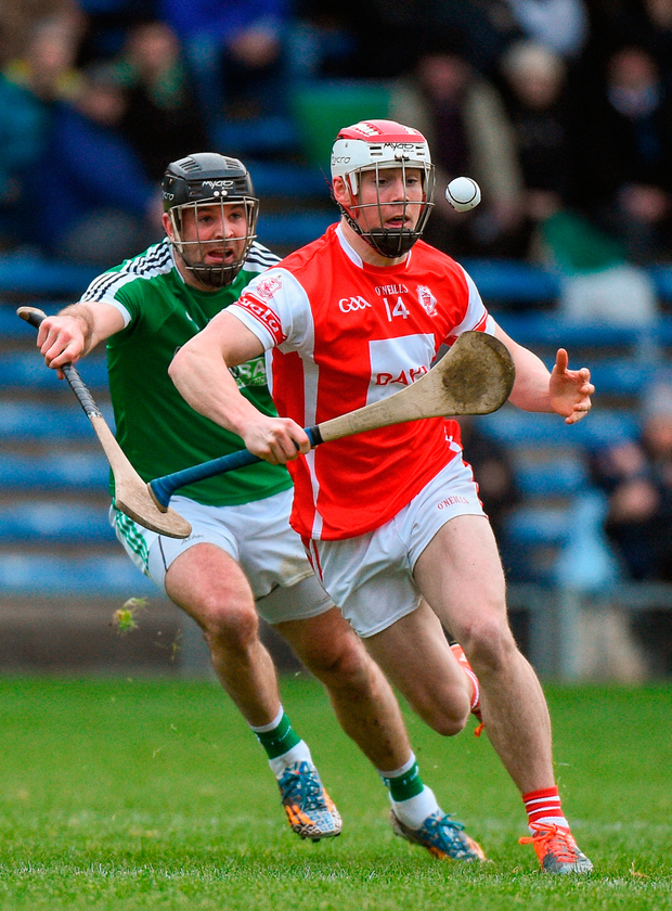 Con O'Callaghan of Cuala in action against David Collins of Liam Mellows. Photo: Matt Browne/Sportsfile