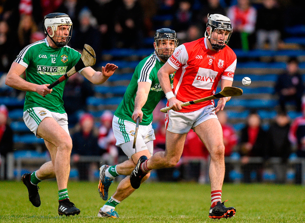 Jake Malone of Cuala in action against Adrian Morrissey and David Collins of Liam Mellows. Photo: Matt Browne/Sportsfile