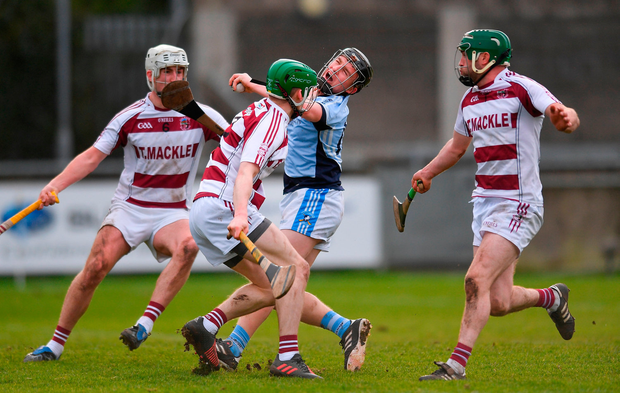 Peter Casey of Na Piarsaigh in action against Paul McNeill of Slaughtneil. Photo by Eóin Noonan/Sportsfile