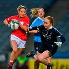 Orla Finn of Cork in action against Ciara Trant and Martha Byrne, behind, of Dublin. Photo: Piaras Ó Mídheach/Sportsfile