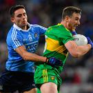 Donegal's Leo McLoone is tackled by Dublin's Niall Scully. Photo: Brendan Moran/Sportsfile