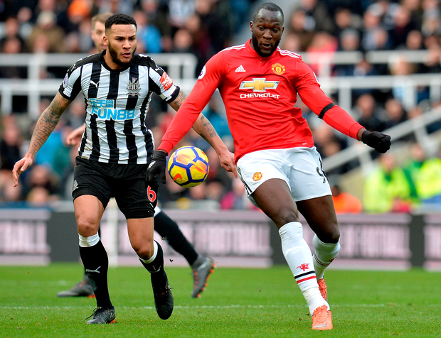 Manchester United's Romelu Lukaku is challenged by Newcastle United's Jamaal Lascelles. Photo: Getty Images
