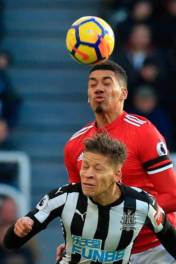Manchester United's Chris Smalling out-jumps Newcastle United's Dwight Gayle. Photo: Getty Images