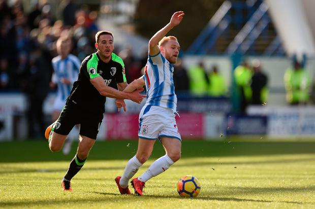 Bournemouth's Dan Gosling challenges Huddersfield's Alex Pritchard. Photo: Getty Images