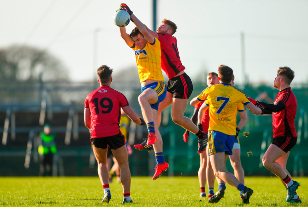 Enda Smith of Roscommon in action against Caolán Mooney of Down. Photo: Daire Brennan/Sportsfile