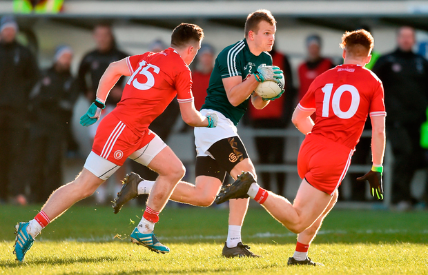 Peter Kelly of Kildare in action against Connor McAliskey, left, and Conor Meyler of Tyrone. Photo: Piaras Ó Mídheach/Sportsfile