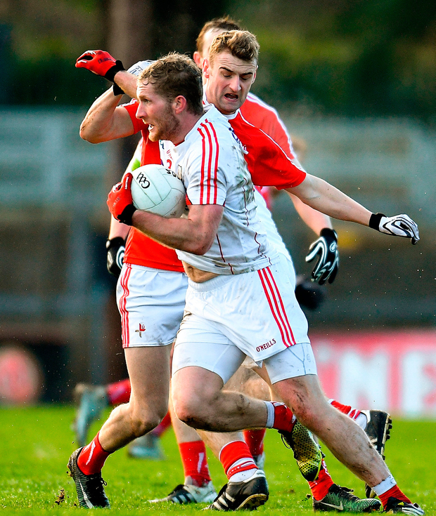 Ruairi Deane of Cork in action against Gerald McSorley of Louth. Photo: Eóin Noonan/Sportsfile