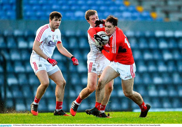 Derek Maguire of Louth in action against Matthew Taylor of Cork. Photo: Eóin Noonan/Sportsfile