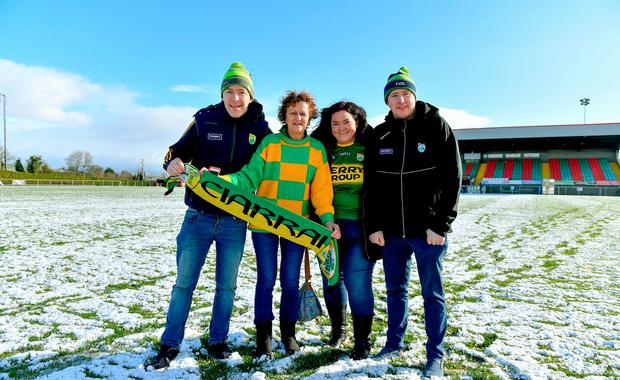 Kerry supporters, from left, John Creedon, Emer Hogan, Karen Hurley and Donal McCarthy on the pitch in Grattan Park after the game with Monaghan was called off. Photo: Brendan Moran/Sportsfile