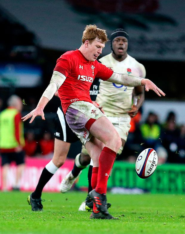Wales' Rhys Patchell kicks the ball. Photo: PA
