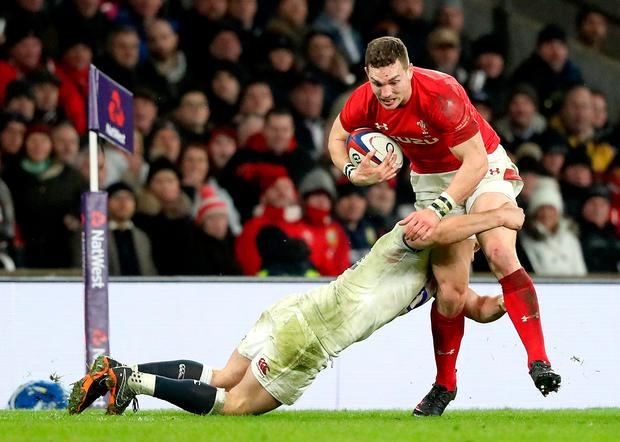Wales' George North is tackled. Photo: PA