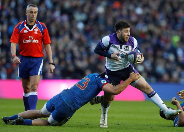 Scotland's Ali Price is tackled by France's Remi Lamerat. Photo: Reuters
