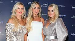 Claudine Keane with her mother Joan Palmer, left, and Roz Flanagan, right, at The CARI Red Ball at The Radisson Blu Hotel, Golden Lane, Dublin. Picture: Brian McEvoy